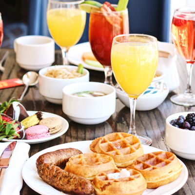 Waffles, sausage, and Mimosa Brunch